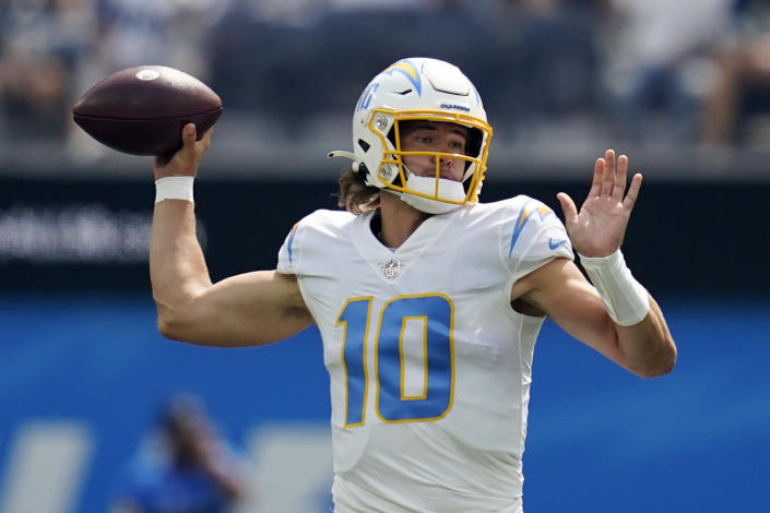 Los Angeles Chargers quarterback Justin Herbert (10) throws during the first half of an NFL football game against the Dallas Cowboys Sunday, Sept. 19, 2021, in Inglewood, Calif. (AP Photo/Ashley Landis )