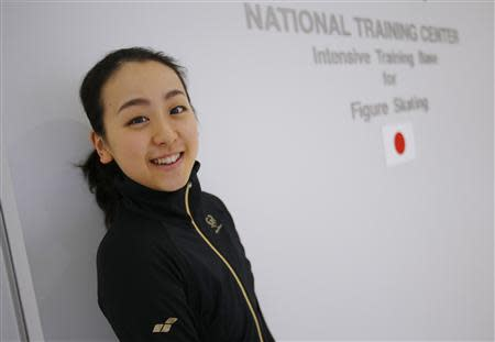 Japanese figure skater Mao Asada poses for a photo at the National Training Center, an intensive training base for figure skating, at Chukyo University in Toyota, central Japan November 27, 2013. REUTERS/Issei Kato