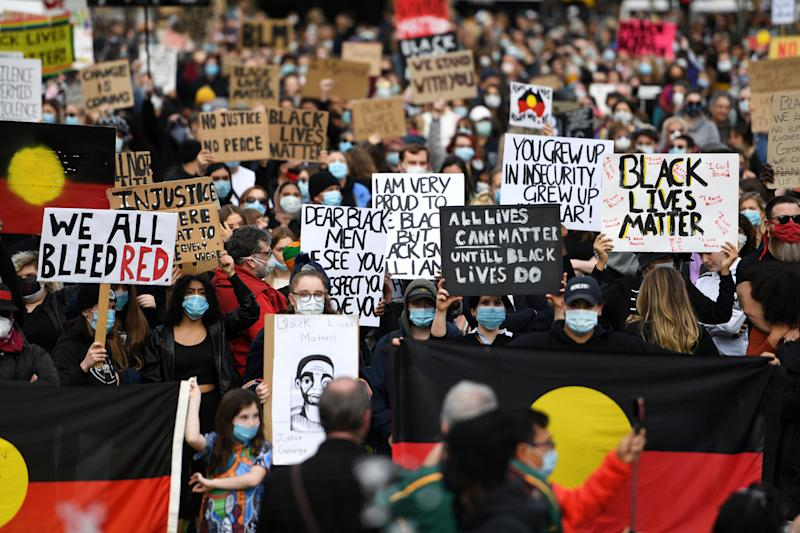 ADELAIDE, AUSTRALIA - JUNE 06: Protesters march in solidarity with protests in the United States on June 06, 2020 in Adelaide, Australia. Events across Australia have been organised in solidarity with protests in the United States following the killing of an unarmed black man George Floyd at the hands of a police officer in Minneapolis, Minnesota and to rally against aboriginal deaths in custody in Australia. (Photo by Tracey Nearmy/Getty Images)