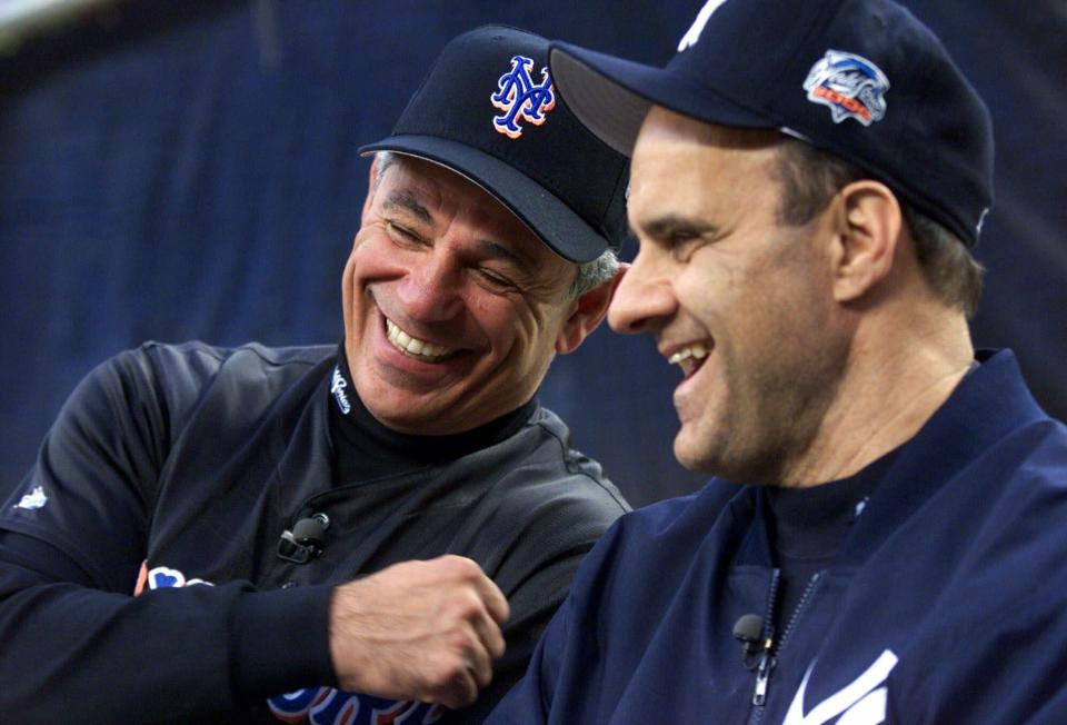 FILE- In this Oct. 21, 2000, file photo, New York Mets manager Bobby Valentine, left, and New York Yankees manager Joe Torre give an interview prior to the start of a World Series baseball game in New York. Sports teams will hold ceremonies Saturday to mark the 20th anniversary of the Sept. 11 terrorist attacks. Valentine, manager of the 2001 Mets, will throw a ceremonial first pitch to Torre, manager of the 2001 Yankees. (AP Photo/Jeff Zelevanksy, File)