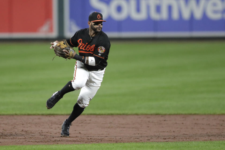 Baltimore Orioles shortstop Jonathan Villar fields a ground ball hit by Seattle Mariners' Shed Long during the third inning of a baseball game, Friday, Sept. 20, 2019, in Baltimore. (AP Photo/Julio Cortez)