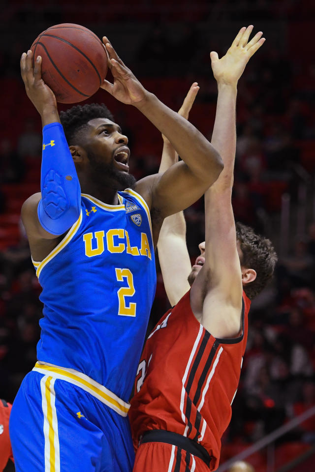 UCLA forward Cody Riley (2) looks to shoot over Utah forward Riley Battin during the first half of an NCAA college basketball game Thursday, Feb. 20, 2020, in Salt Lake City. (AP Photo/Alex Goodlett)