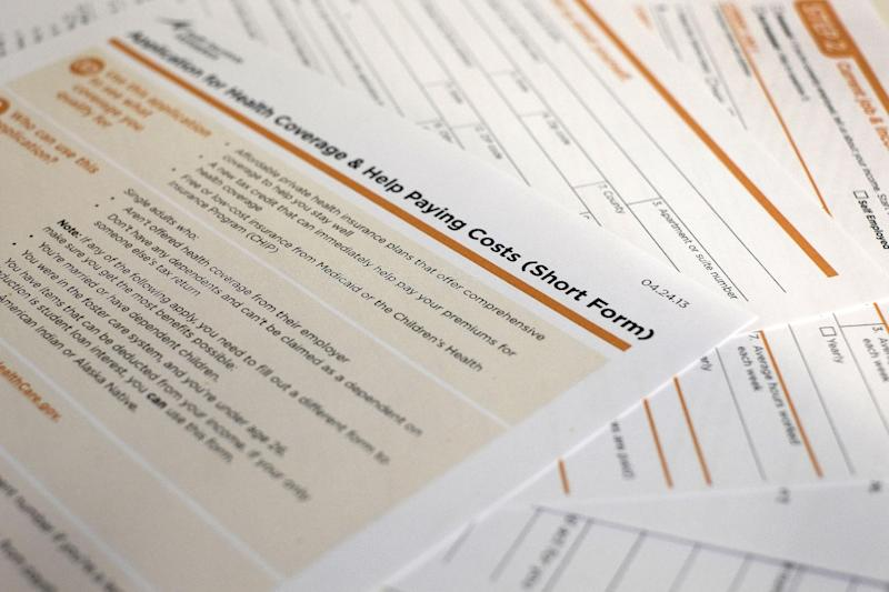 This application obtained by The Associated Press shows the short form for the new federal Affordable Care Act. The first draft was as mind-numbing as a tax form. Tuesday the Obama administration unveiled simplified application forms for health insurance benefits under the federal health care overhaul. The biggest change: a five-page short form that single people can fill out. That total includes a cover page with instructions, and an extra page to fill out if you want to designate someone to help you through the process. (AP Photo/J. David Ake)