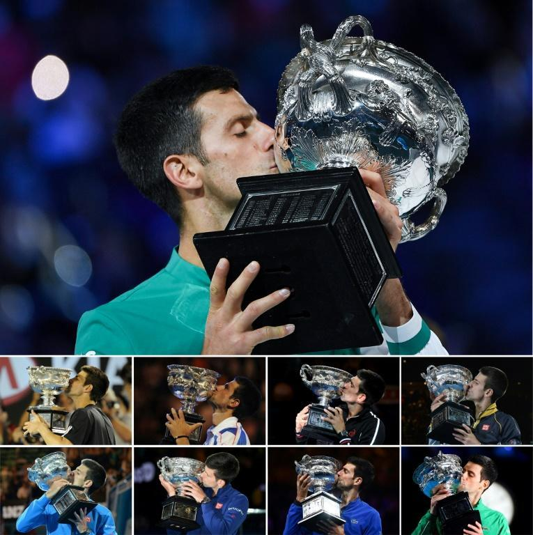 Serbia's Novak Djokovic kisses the Norman Brookes Challenge Cup after each of his nine Australian Open wins