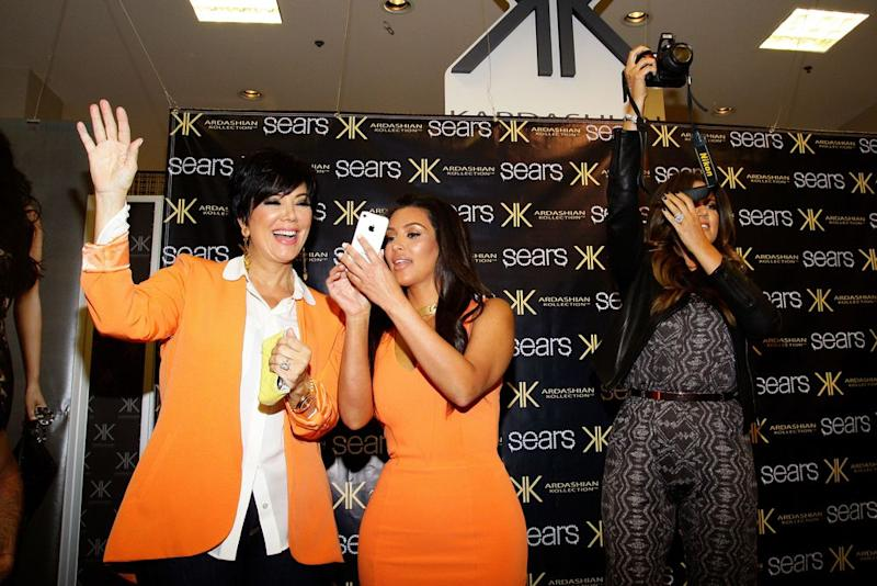 From left: Kris Jenner and Kim and Khloé Kardashian promote their clothing line at a Sears in Schaumburg, Ill., in 2012. | Raymond Boyd—Michael Ochs Archives/Getty Images