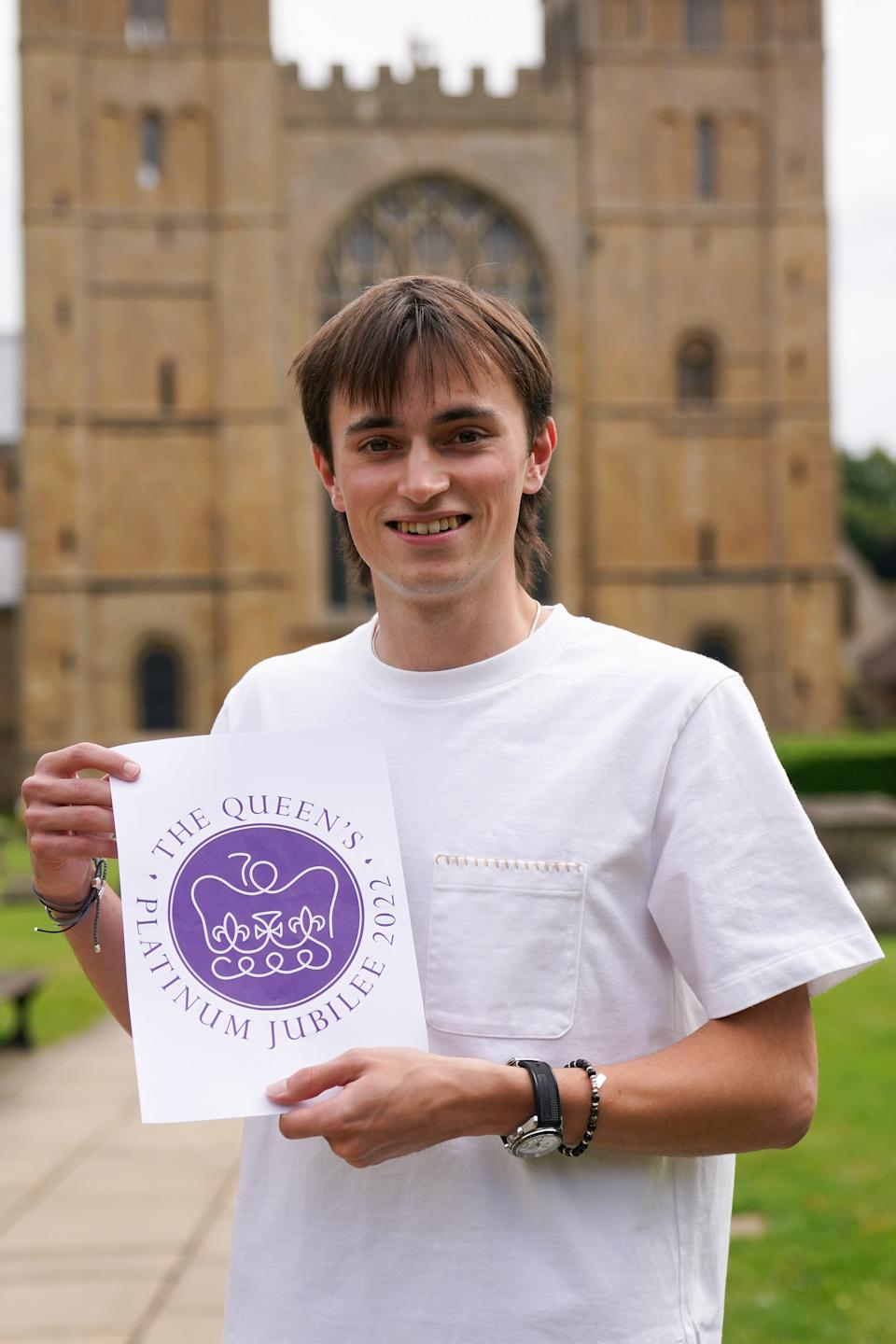 Embargoed to 0001 BST Tuesday August 3, 2021. Edward Roberts in the grounds of Southwell Minster in Nottinghamshire with his winning design for The Queen's Platinum Jubilee Emblem Competition. In 2022 Queen Elizabeth II will become the first British Monarch to celebrate a Platinum Jubilee - seventy years of service - having acceded to the throne on 6th February 1952. Picture date: Monday August 2, 2021.
