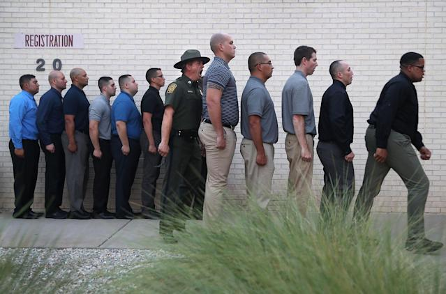 <p>A U.S. Border Patrol instructor yells at trainees after their initial arrival to the U.S. Border Patrol Academy on August 2, 2017 in Artesia, N.M. (Photo: John Moore/Getty Images) </p>