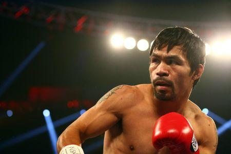 FILE PHOTO - April 9, 2016; Las Vegas, NV, USA; Manny Pacquiao fights against Timothy Bradley at MGM Grand Garden Arena. Mandatory Credit: Mark J. Rebilas-USA TODAY Sports / Reuters
