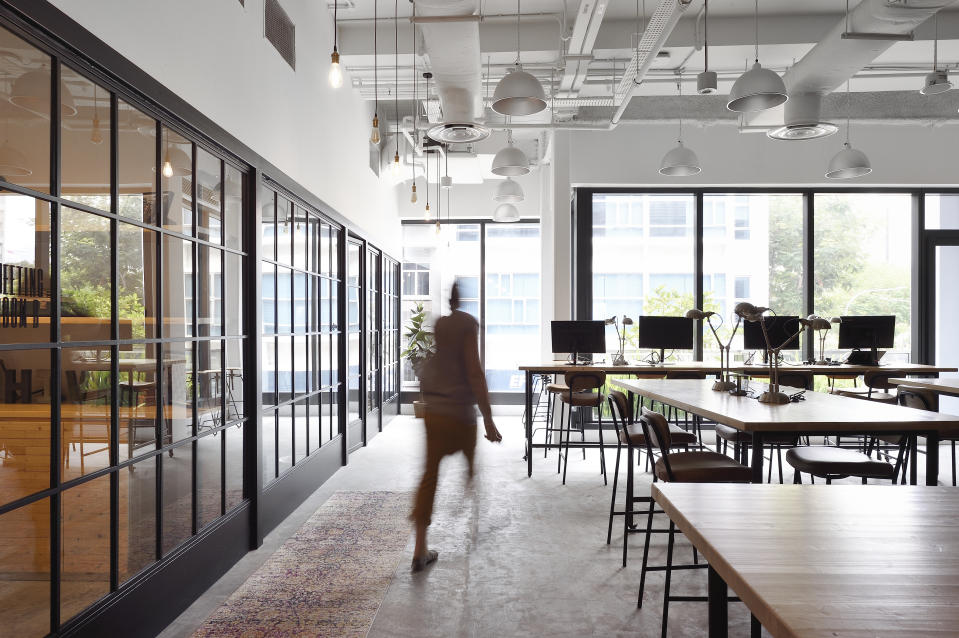 Woman walking through a co-working office