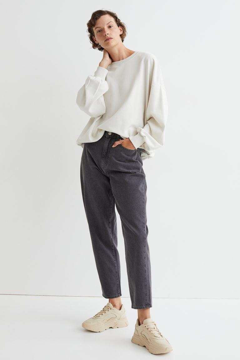 Mom Loose-fit Ultra High Jeans in grey-black wash. Image via H&M.
