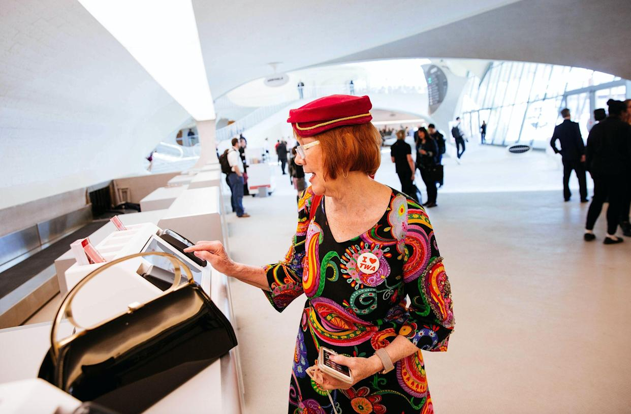Guest Billie O'Hagan, a flight attendant at Alaska Airlines, checks in at the front desk in the new TWA Hotel at JFK Airport on May 15, 2019 in New York City. (Photo: Kevin Hagen/Getty Images)