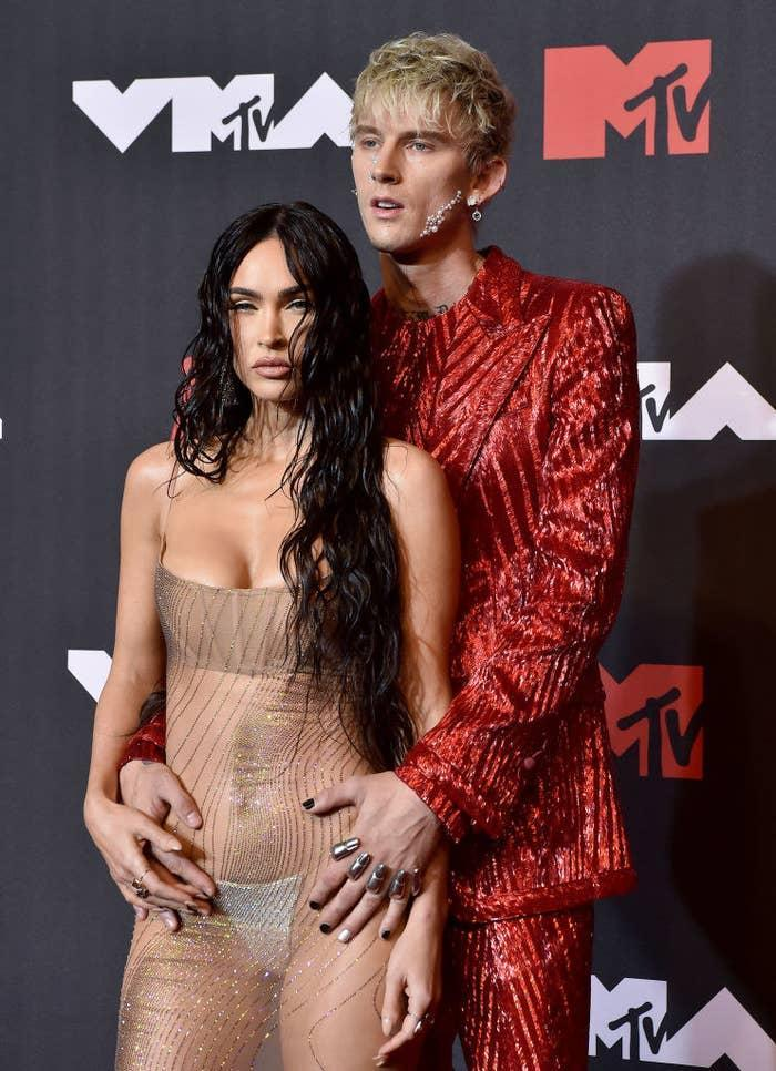 Megan wore a see-through dress and MGK wore a sparkly suit and rhinestones on his face