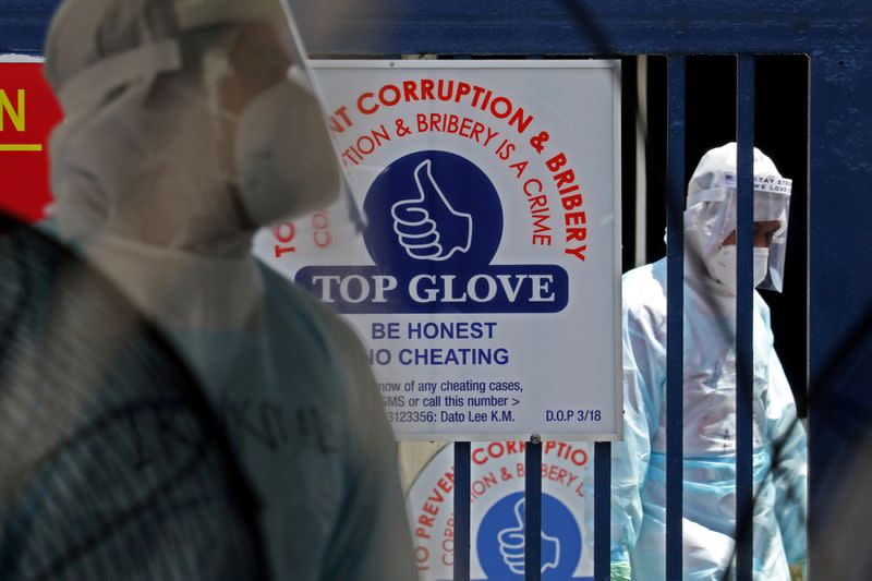 FILE PHOTO: Medical workers are seen at a Top Glove hostel under enhanced lockdown in Klang