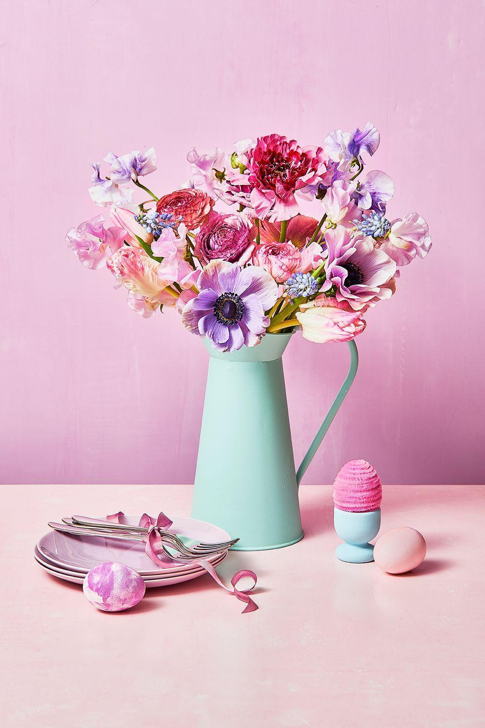 <p>Use a mint green vase as the foundation for a statement arrangement full of pastel-colored flowers. </p>
