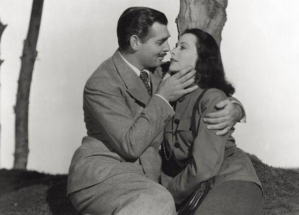 <p>Clark Gable and Hedy Lamarr in the film <em>Comrade X</em>. Lamarr wears a military-style jacket and pencil skirt. </p>
