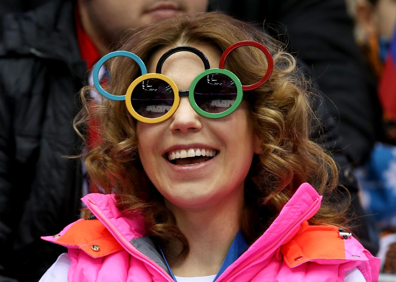 SOCHI, RUSSIA - FEBRUARY 14: A fan looks on with Olympic rings glasses during the Men's Ice Hockey Preliminary Round Group C game between Czech Republic and Latvia on day seven of the Sochi 2014 Winter Olympics at Bolshoy Ice Dome on February 14, 2014 in Sochi, Russia. (Photo by Bruce Bennett/Getty Images)