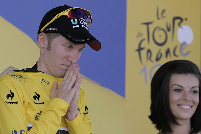 Jan Bakelants of Belgium, wearing the overall leader's yellow jersey, celebrates on the podium of the third stage of the Tour de France cycling race over 145.5 kilometers (91 miles) with start in Ajaccio and finish in Calvi, Corsica island, France, Monday July 1, 2013. (AP Photo/Christophe Ena)