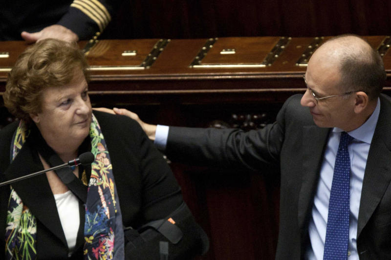 Italian Premier Enrico Letta, right, puts his hand on the shoulder of Justice Minister Annamaria Cancellieri ahead of a confidence vote at the Italian Lower Chamber of Parliament, in Rome, Wednesday, Nov. 20, 2013. Italy's justice minister has denied intervening to free a family friend from jail in an address to lawmakers as she faced a confidence vote. Cancellieri has been under pressure to resign following revelations that, while minister, she called the friend's companion to express sympathy after her arrest for alleged false accounting. Cancellieri told Parliament ahead of the Wednesday confidence vote that she regretted the personal phone call, but insisted that she had shown no professional favoritism. She has the support Premier Enrico Letta, who sought to ensure center-left lawmakers' support Cancellieri by linking the confidence vote to the survival of his government. (AP Photo/Mauro Scrobogna, Lapresse) ITALY OUT