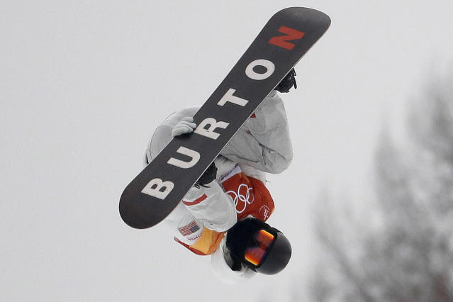 FILE - In this Feb. 14, 2018, file photo, Shaun White, of the United States, jumps during the men's halfpipe finals at Phoenix Snow Park at the 2018 Winter Olympics in Pyeongchang, South Korea. Jake Burton Carpenter, the man who changed the game on the mountain by fulfilling a grand vision of what a snowboard could be, died Wednesday night, Nov. 21, 2019, of complications stemming from a relapse of testicular cancer. He was 65. (AP Photo/Lee Jin-man, File)