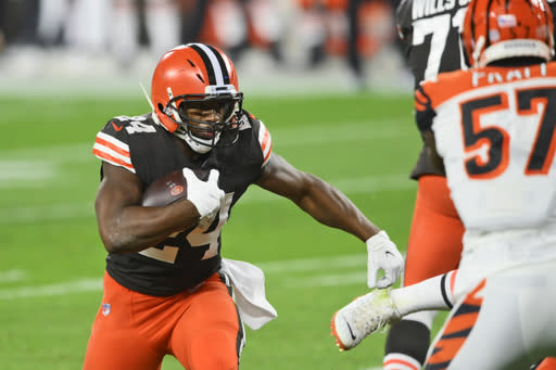 Cleveland Browns running back Nick Chubb rushes for an 11-yard touchdown during the first half of the team's NFL football game against the Cincinnati Bengals, Thursday, Sept. 17, 2020, in Cleveland. (AP Photo/David Richard)