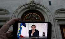 French President Emmanuel Macron again defended not locking down in January, citing recent such measures in Germany and Italy