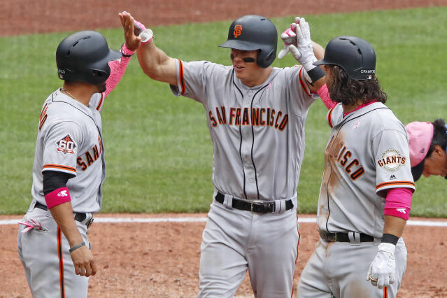 San Francisco Giants' Nick Hundley, center, celebrates with Gregor Blanco, left, and Brandon Crawford after hitting a three-run home run off Pittsburgh Pirates relief pitcher Richard Rodriguez in the sixth inning of a baseball game in Pittsburgh, Sunday, May 13, 2018. (AP Photo/Gene J. Puskar)