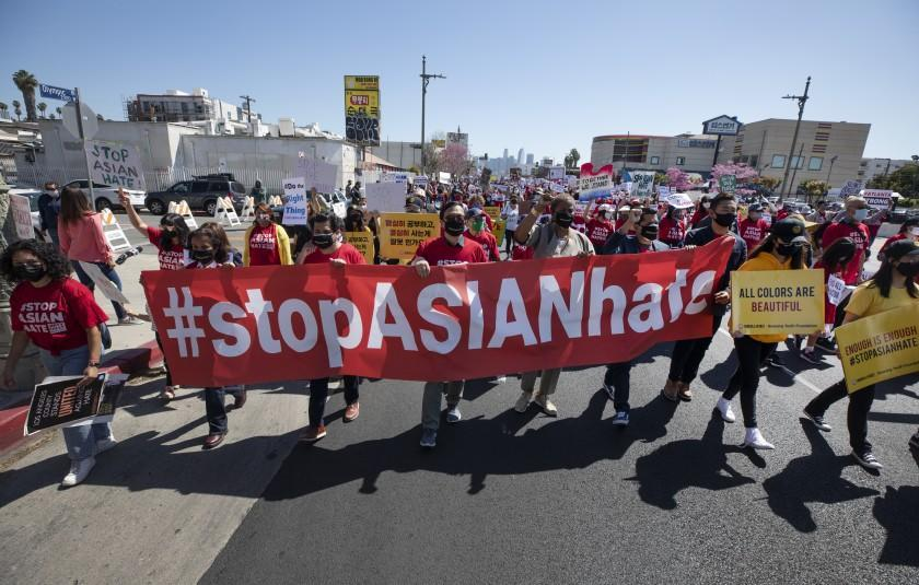 """LOS ANGELES, CA - MARCH 27: Hundreds participated in a """"Stop Asian Hate"""" rally in Koreatown on Saturday, March 27, 2021. (Myung J. Chun / Los Angeles Times)"""