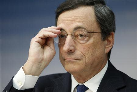 European Central Bank President Draghi adjusts his glasses during the monthly ECB news conference in Frankfurt