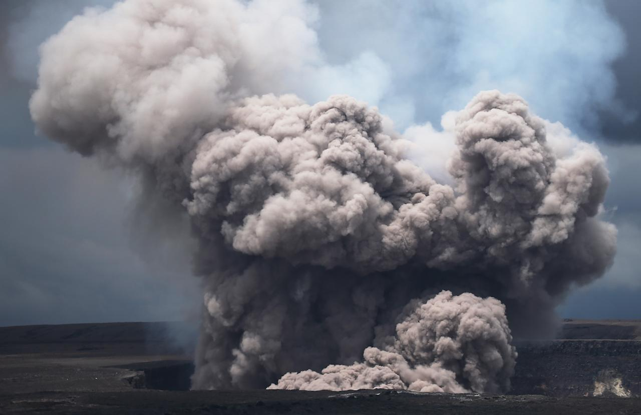 <p>Huge plumes of smoke have been seen rising from the volcano (Getty) </p>