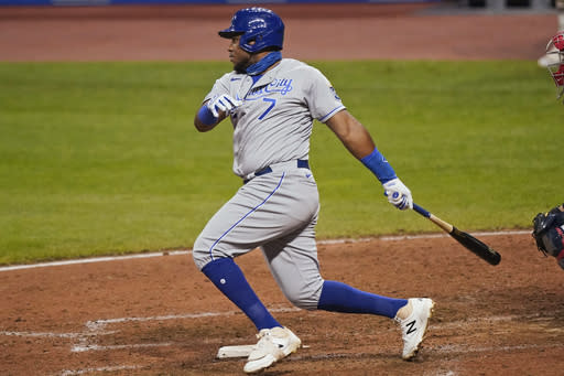 Kansas City Royals' Maikel Franco watches an RBI single during the ninth inning of the team's baseball game against the Cleveland Indians, Tuesday, Sept. 8, 2020, in Cleveland. The Royals won 8-6. (AP Photo/Tony Dejak)
