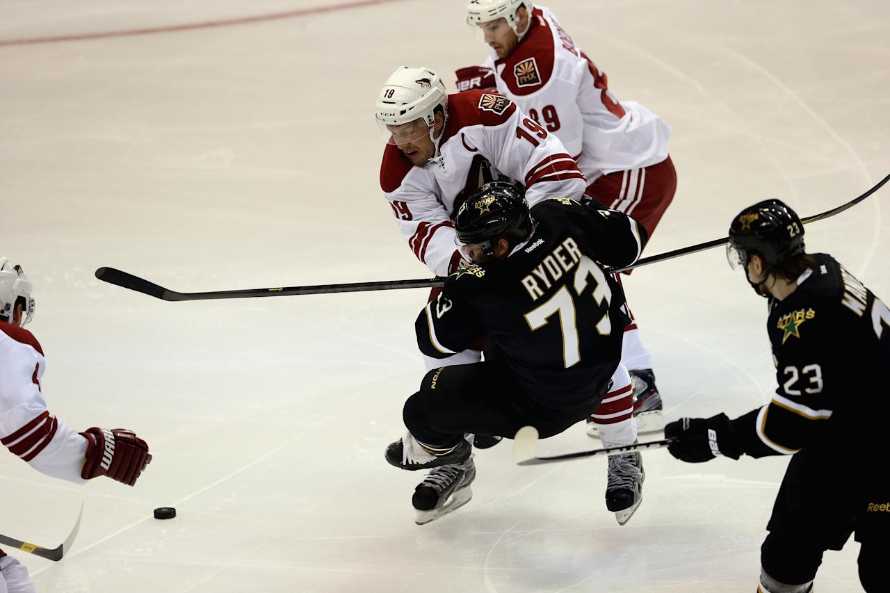 DALLAS, TX - JANUARY 19:  Shane Doan #19 of the Phoenix Coyotes checks Michael Ryder #73 of the Dallas Stars on opening night at American Airlines Center on January 19, 2013 in Dallas, Texas.  (Photo by Ronald Martinez/Getty Images)