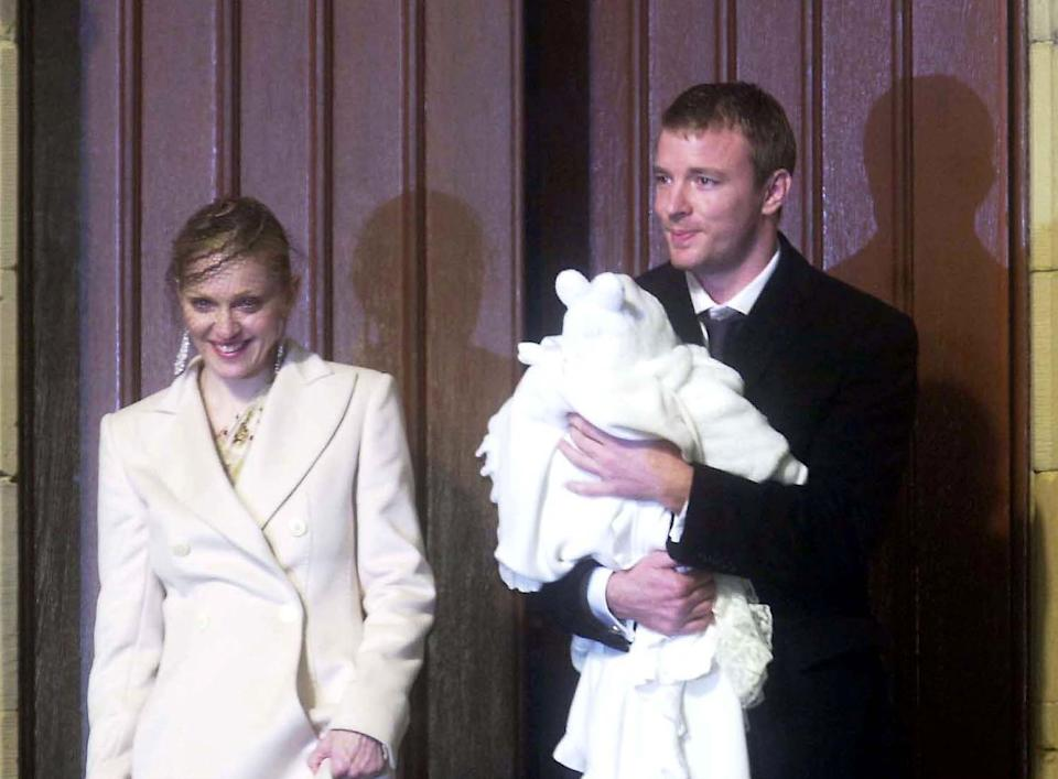 Madonna and Guy Ritchie attend the baptism of their son Rocco at Dornoch Cathedral December 21, 2000 in Scotland. (Photo by Antony Jones/UK Press/Newsmakers)