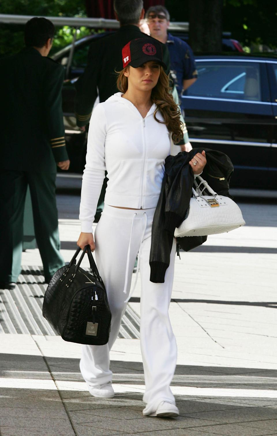 <p>Turns out, Cheryl sported athleisure before the fashion industry even coined the term. The former Girls Aloud star was photographed leaving Brenners Park Hotel the day after England lost in the 2006 World Cup donning a velour tracksuit. In true noughties fashion, she teamed the look with a miniature handbag and pap-shielding cap. <em>[Photo: Getty]</em> </p>