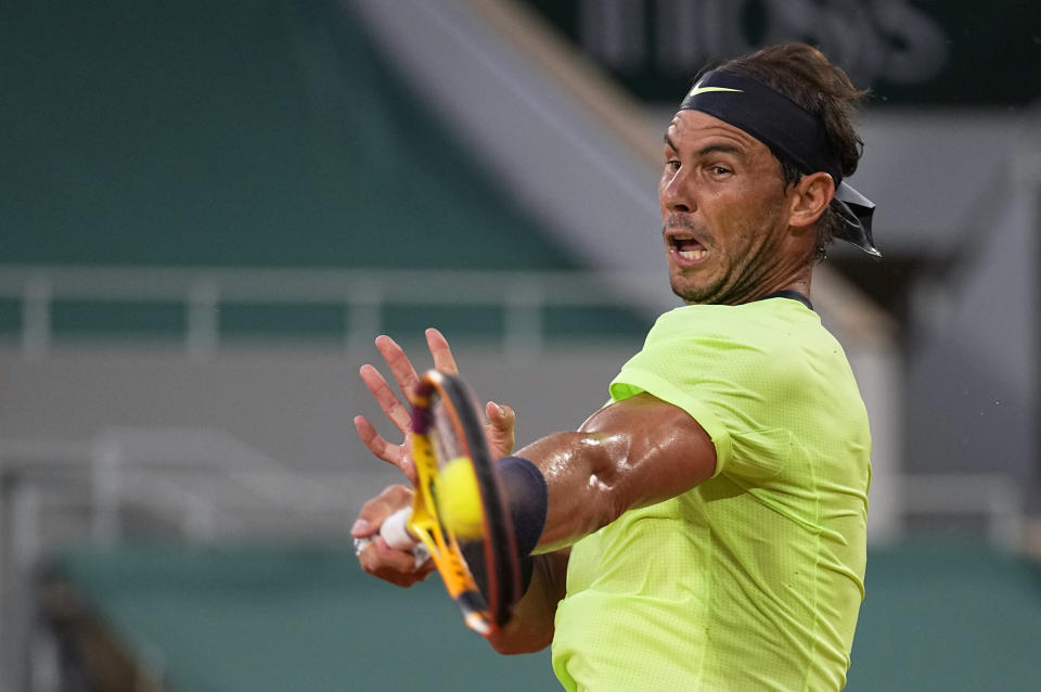 Spain's Rafael Nadal plays a return to Richard Gasquet of France during their second round match on day 5, of the French Open tennis tournament at Roland Garros in Paris, France, Thursday, June 3, 2021. (AP Photo/Michel Euler)