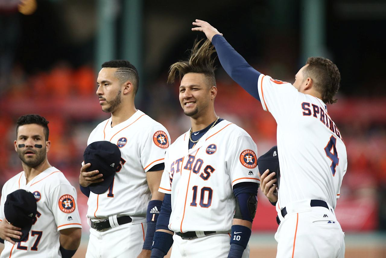 Oct 20, 2017; Houston, TX, USA; Houston Astros center fielder George Springer (4) pulls the hair of first baseman Yuli Gurriel (10) as second baseman Jose Altuve (27) and shortstop Carlos Correa (1) look on at left before game six of the 2017 ALCS playoff baseball series against the New York Yankees at Minute Maid Park. Mandatory Credit: Troy Taormina-USA TODAY Sports     TPX IMAGES OF THE DAY