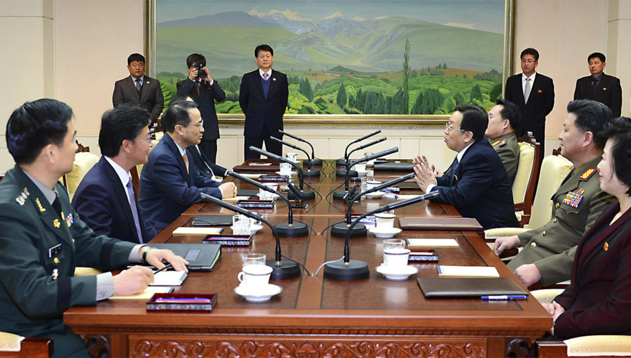 In this photo released by the South Korean Unification Ministry, South Korean chief delegate Kim Kyou-hyun, third from left, talks with his North Korean counterpart Won Tong Yon, third from right, during a meeting at the border village of Panumjom, South Korea, Friday, Feb. 14, 2014. The rival Koreas sat down Friday for a second round of talks this week at a border village as the North's calls for a delay of annual South Korea-U.S. military drills threaten plans for the resumption of emotional reunions of war-divided families. (AP Photo/South Korean Unification Ministry)