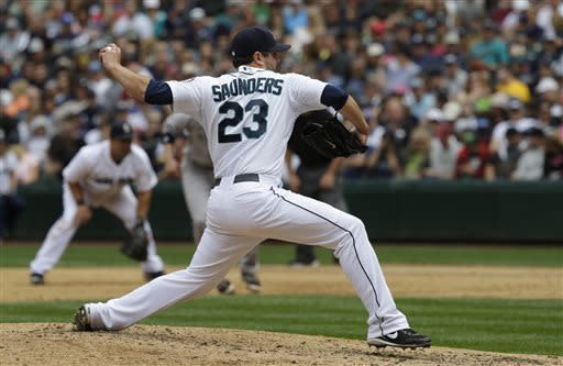 Seattle Mariners starting pitcher Joe Saunders throws against the New York Yankees in the fifth inning of a baseball game on Saturday, June 8, 2013, in Seattle. (AP Photo/Ted S. Warren)