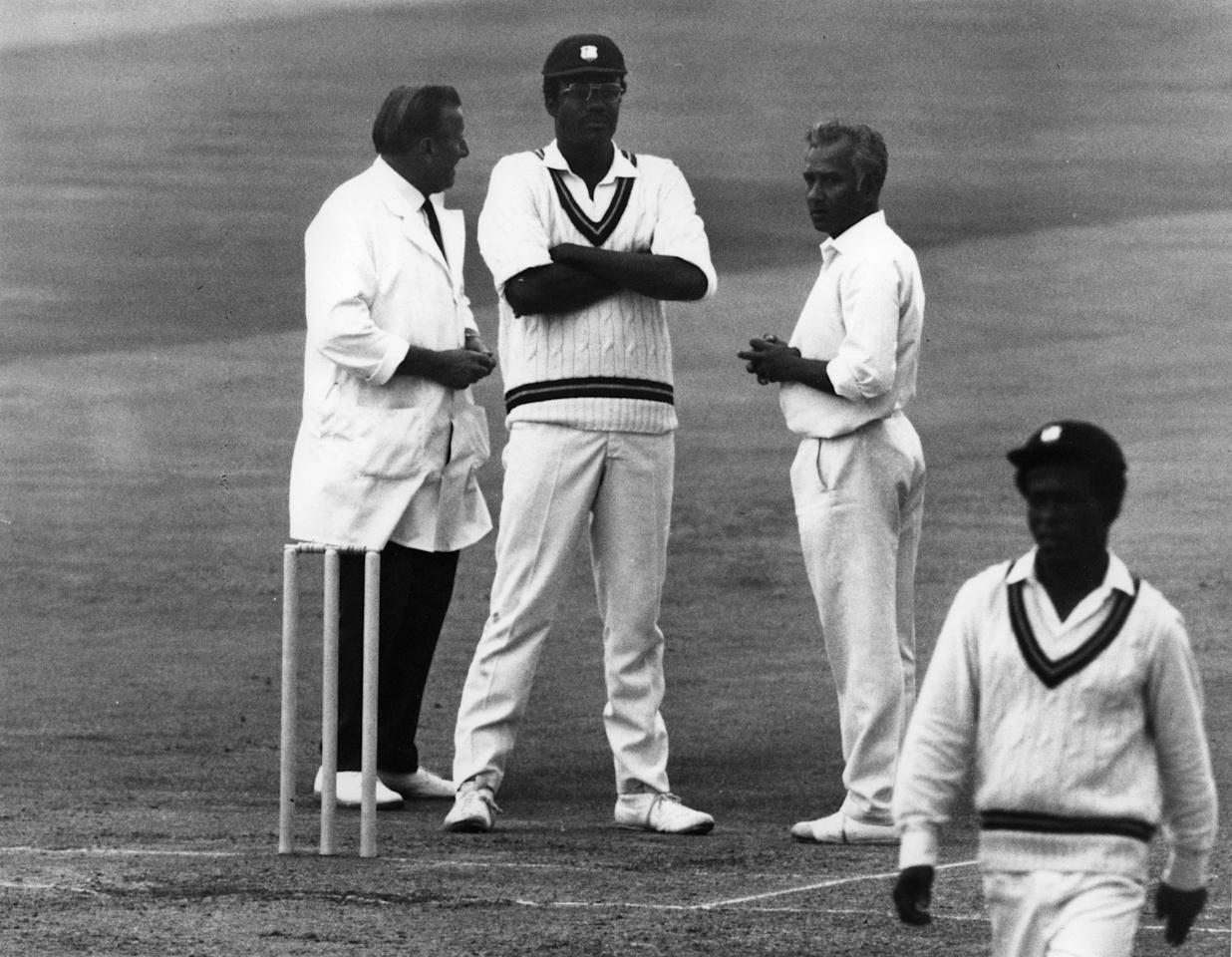 11th August 1973:  Arthur Fagg, the umpire who walked out of a match at Edgbaston, chats amiably with Rohan Kanhai, the West Indies skipper and one of the people he'd argued with.  (Photo by Central Press/Getty Images)
