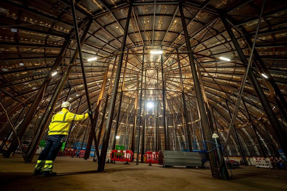 A construction worker stands inside a welded steel dome at Hinkley Point C nuclear power plant (Ben Birchall/PA) (PA Wire)
