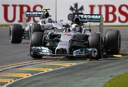Mercedes Formula One driver Lewis Hamilton of Britain (R) drives ahead of Mercedes Formula One driver Nico Rosberg of Germany during the third practice session of the Australian F1 Grand Prix at the Albert Park circuit in Melbourne March 15, 2014. REUTERS/Jason Reed
