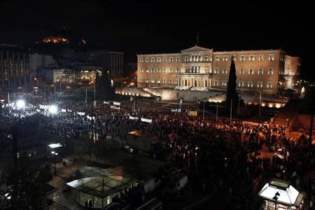 Supporters of the leftist main opposition Syriza party take part in an anti-government rally in front of the parliament in Athens