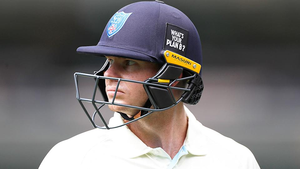 Seen here, Steve Smith looks angry about a decision in the Sheffield Shield match against Victoria.