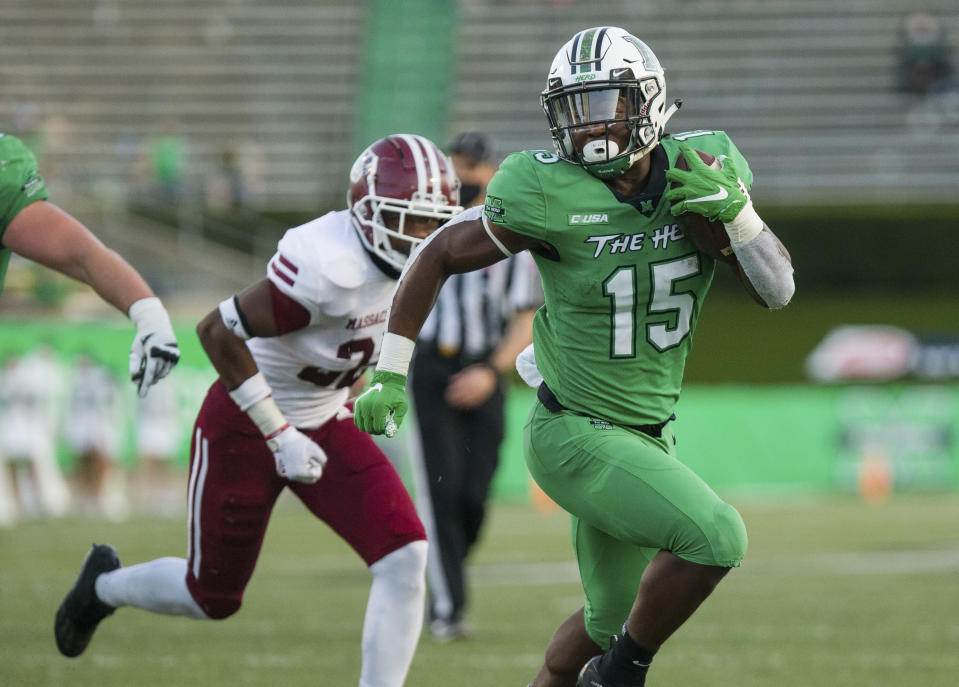 Marshall running back Knowledge McDaniel (15) breaks up field on a carry he would take in for a score against UMass during an NCAA football game on Saturday, Nov. 7, 2020, at Joan C. Edwards Stadium in Huntington, W.Va. (Sholten Singer/The Herald-Dispatch via AP)