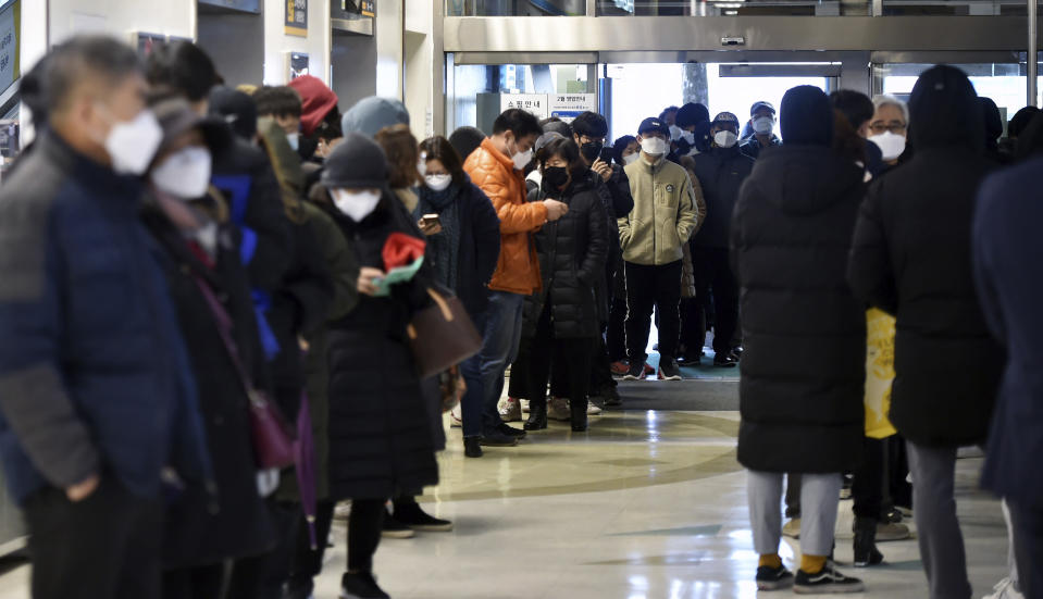 FILE - In this Feb. 24, 2020, file photo, people line up to buy face masks at a store in Daegu, South Korea. Fear of the spreading coronavirus has led to a global run on sales of face masks despite medical experts' advice that most people who aren't sick don't need to wear them. (Lee Moo-ryul/Newsis via AP, File)