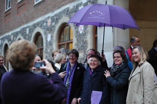 """<p>Female members of the clergy and visitors pose outside the venue of the Church of England General Synod in central London on November 20. The Church of England has """"undoubtedly"""" lost credibility after voting to reject the appointment of women bishops, its leader the Archbishop of Canterbury said Wednesday.</p>"""