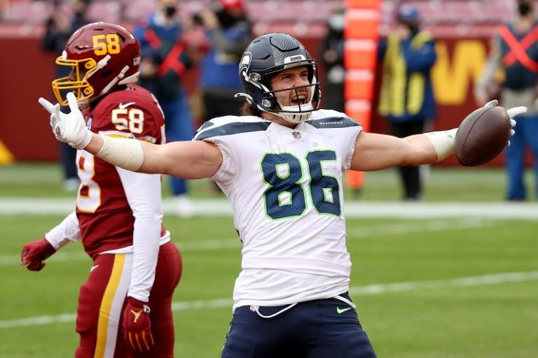 Seattle tight end Jacob Hollister celebrates in front of Washington linebacker Thomas Davis after catching a TD pass in the Seahawks' 20-15 NFL win