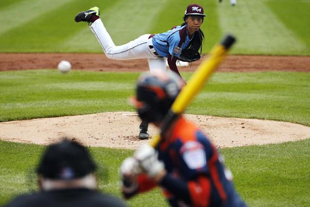 FILE - In this Aug. 15, 2014, file photo, Philadelphia's Mo'ne Davis delivers in the first inning against Nashville's Robert Hassell III during a baseball game in U.S. pool play at the Little League World Series tournament in South Williamsport, Pa. Davis, who became an instant celebrity in August when she became the first girl to win a Little League World Series game, is The Associated Press 2014 Female Athlete of the Year. (AP Photo/Gene J. Puskar, File)