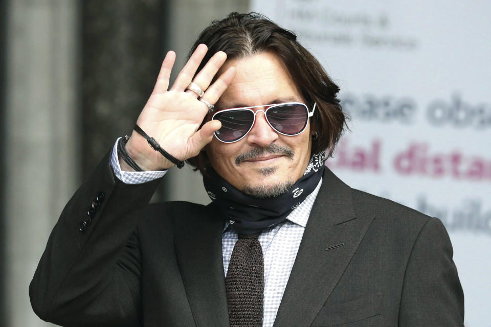 "Actor Johnny Depp arrives at the High Court to give evidence in his libel case, in London, Wednesday July 15, 2020. Depp is suing News Group Newspapers, publisher of The Sun, and the paper's executive editor, Dan Wootton, over an April 2018 article that called him a ""wife-beater."" The Sun's defense relies on a total of 14 allegations by Amber Heard of Depp's violence. He strongly denies all of them. ( Jonathan Brady/PA via AP)"