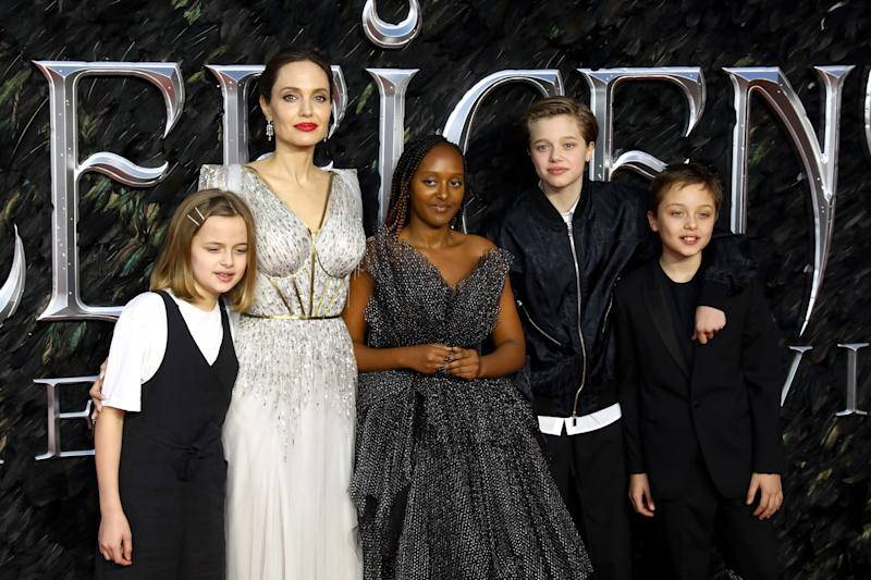 Angelina Jolie, pictured here with her children (L to R): Vivienne, Zahara, Shiloh, and Knox. (Photo: Tim P. Whitby/Getty Images)