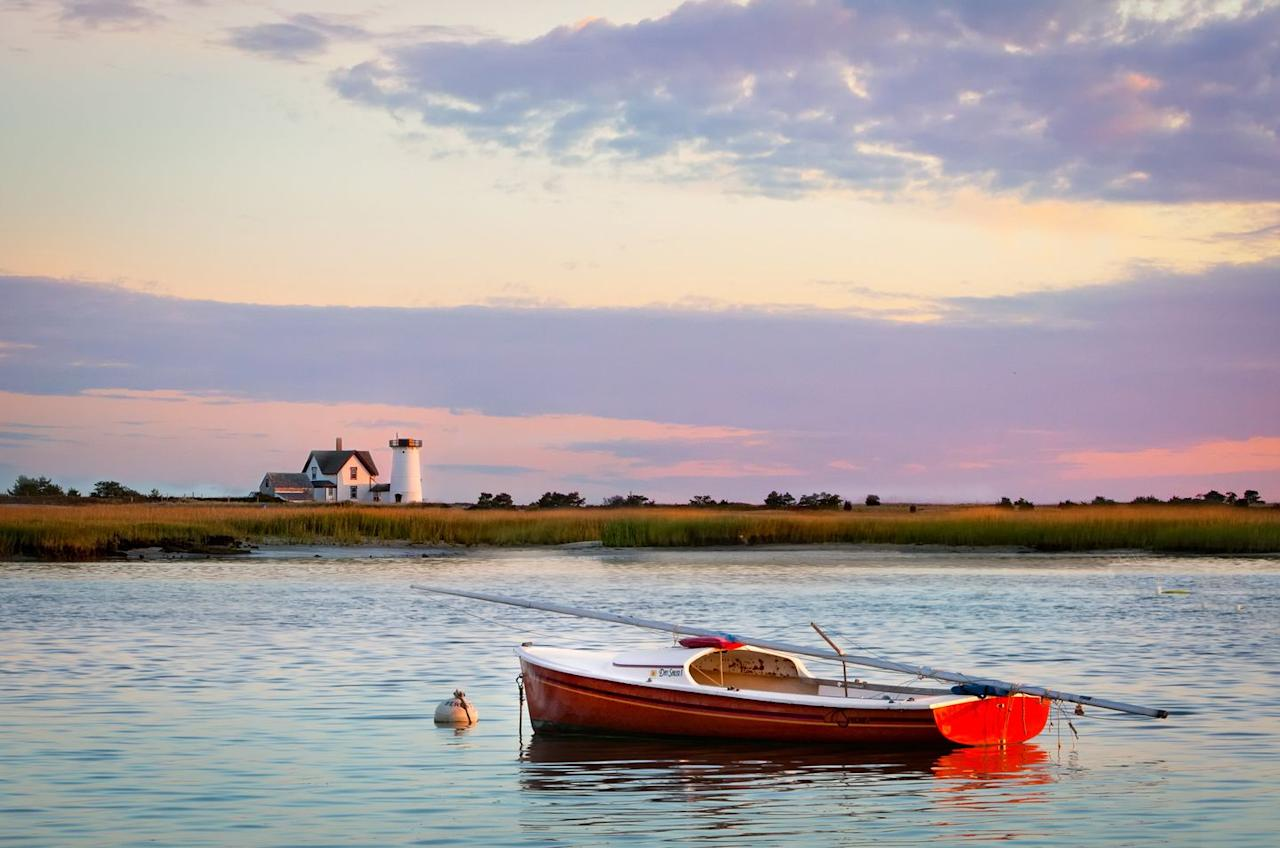 <p>Sunset in Chatham casts a glow on the Stage Harbor lighthouse.</p>